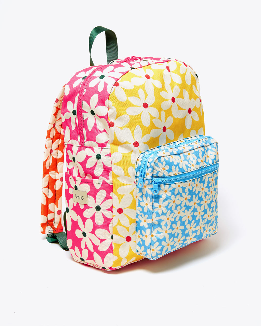 side angle view of daisy backpack showing all pockets