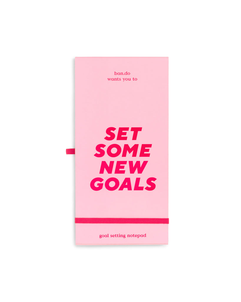 Pink goal tracker notepad with elastic closure and pen loop