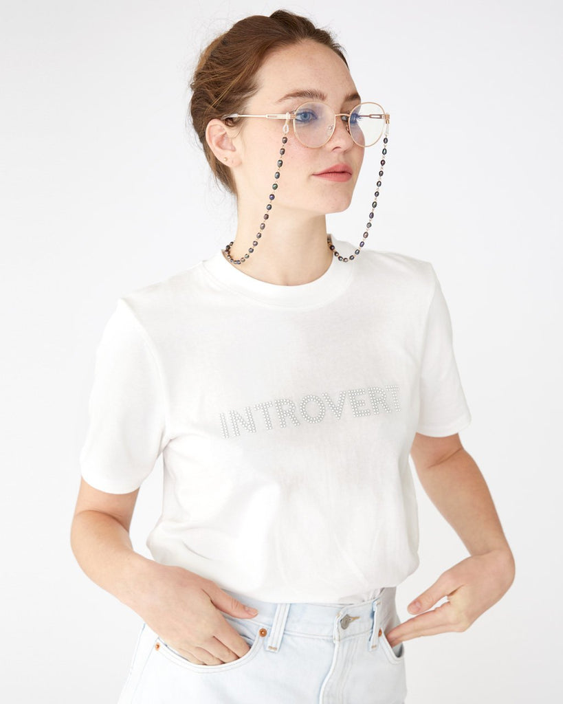 White t-shirt with a faux pearl word art design shown on model
