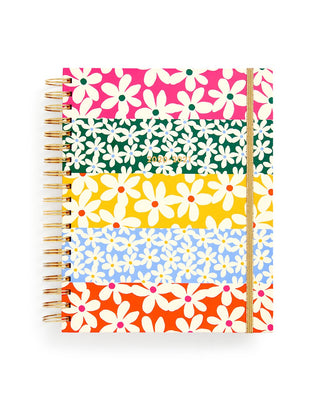 large 17 month planner with a multi colored daisy pattern
