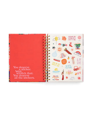 large 17 month planner with a bright pink floral pattern on the cover