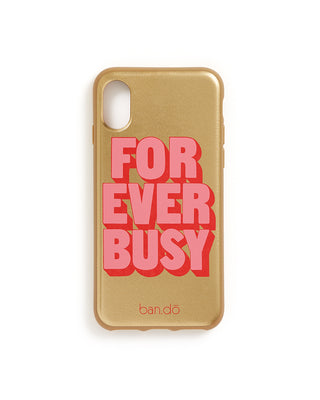 This iPhone case comes in shiny gold with 'Forever Busy' printed in pink on the face.