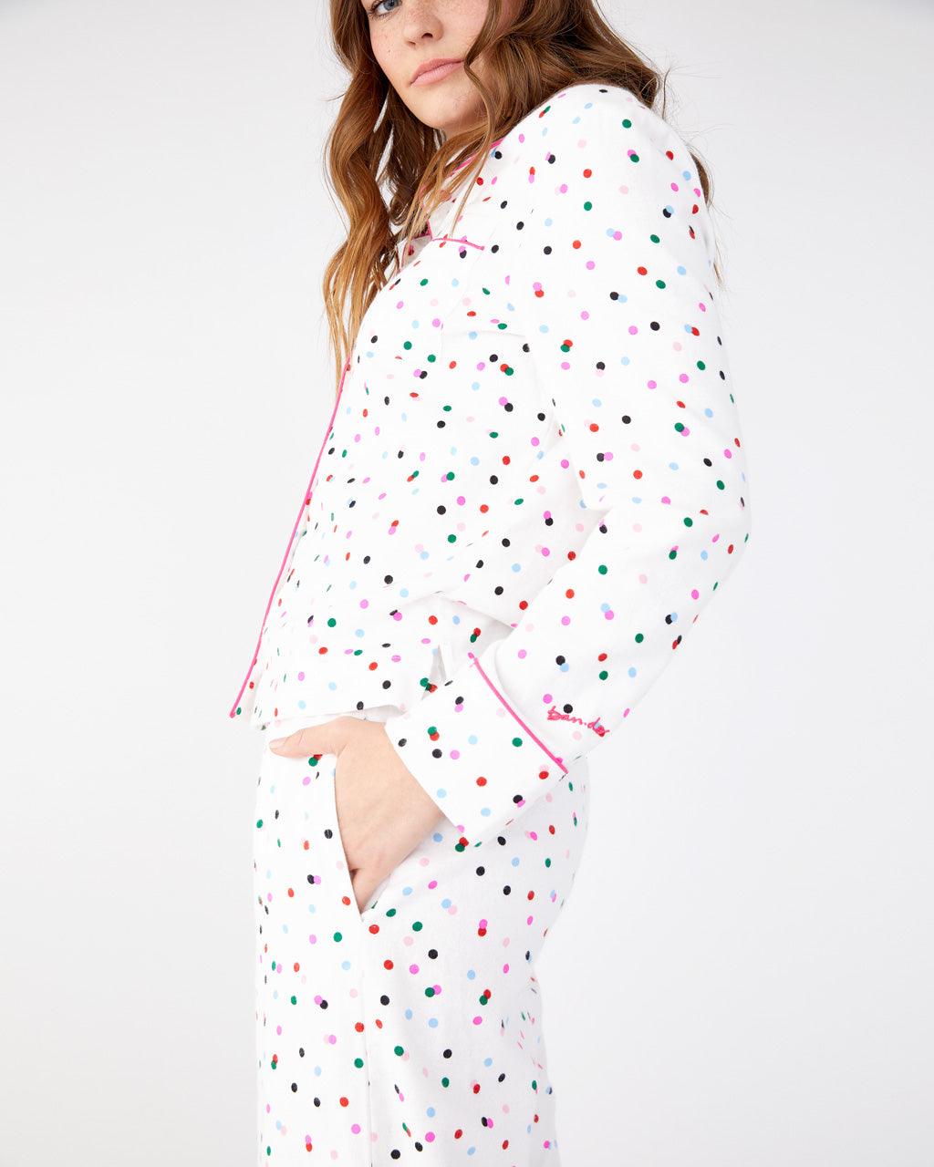Flannel pajama pants with allover multi-color polka dot print and pink drawstring tie.