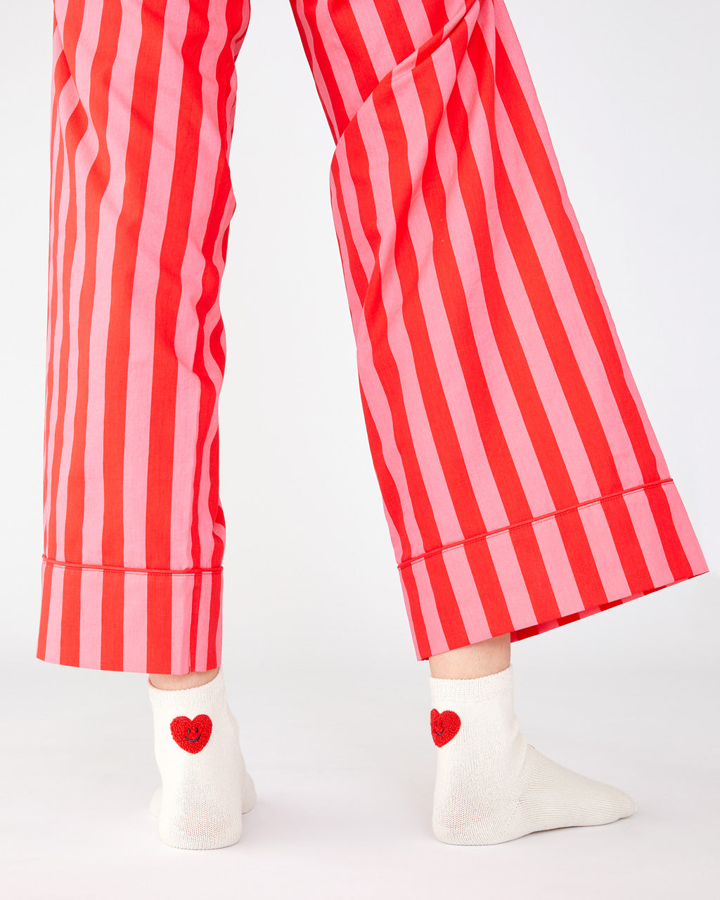 Cotton red and pink vertical stripe leisure pants with a relaxed leg