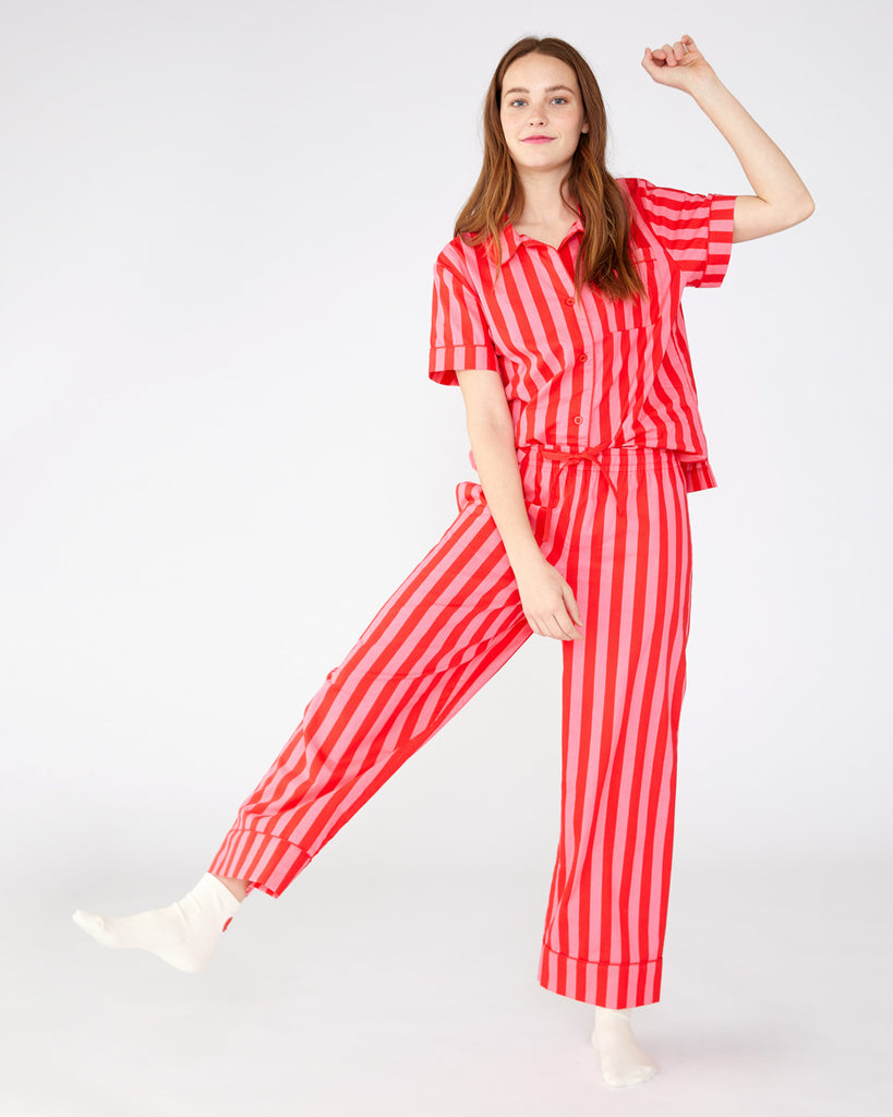 Cotton red and pink vertical stripe leisure pants with a relaxed leg shown on model