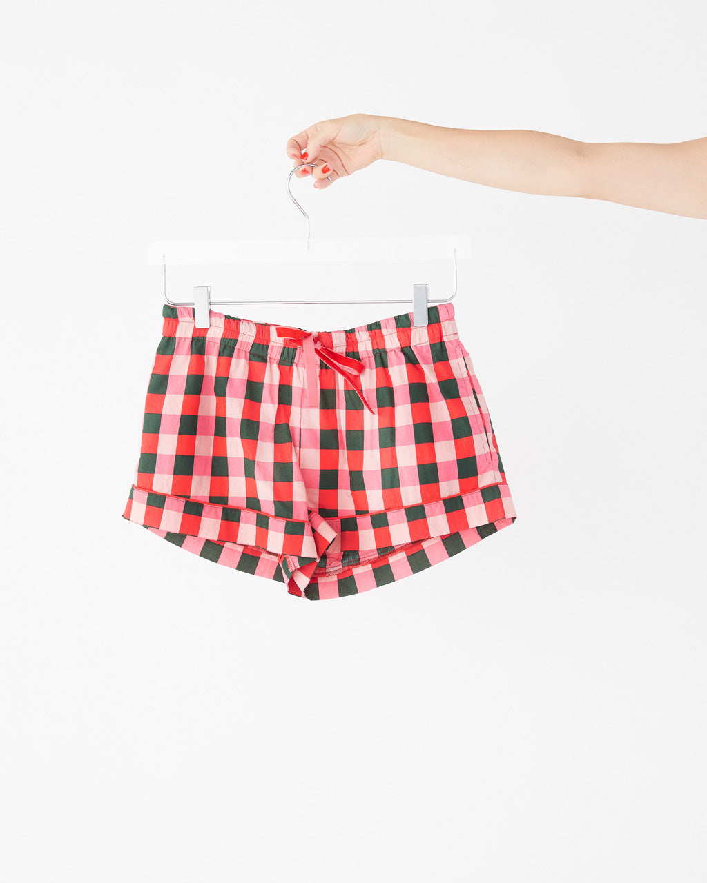Leisure shorts in pink and green buffalo plaid.