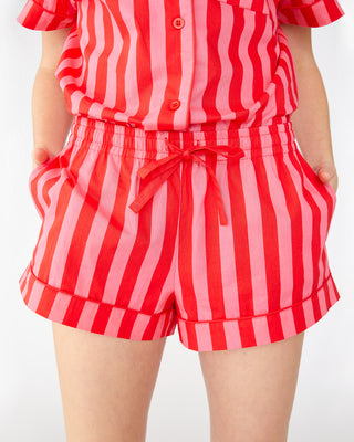 Red and pink vertical stripe leisure shorts shown on model
