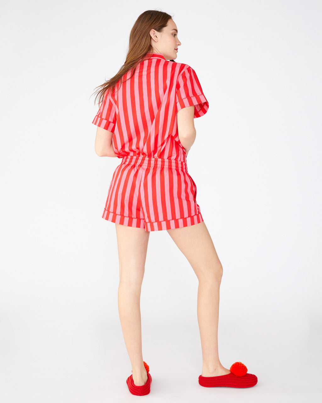 Red and pink vertical stripe leisure shorts with side seam pockets shown on model