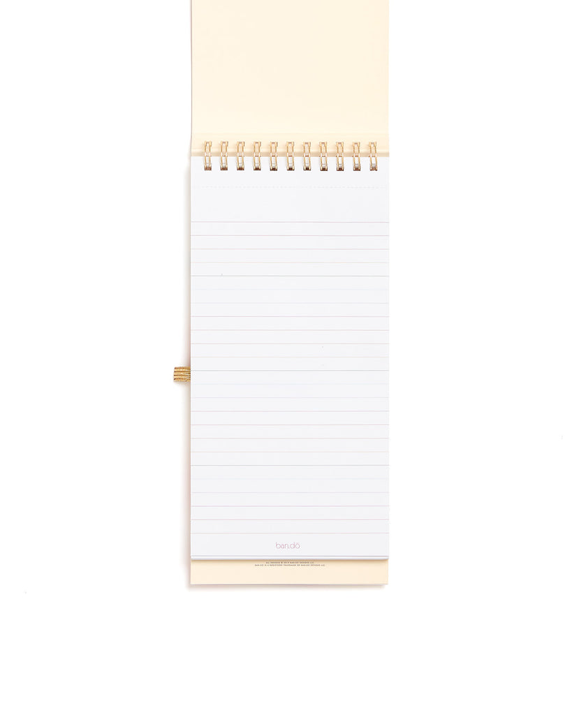 80 perforated top-edge sheets and an elastic pen loop.
