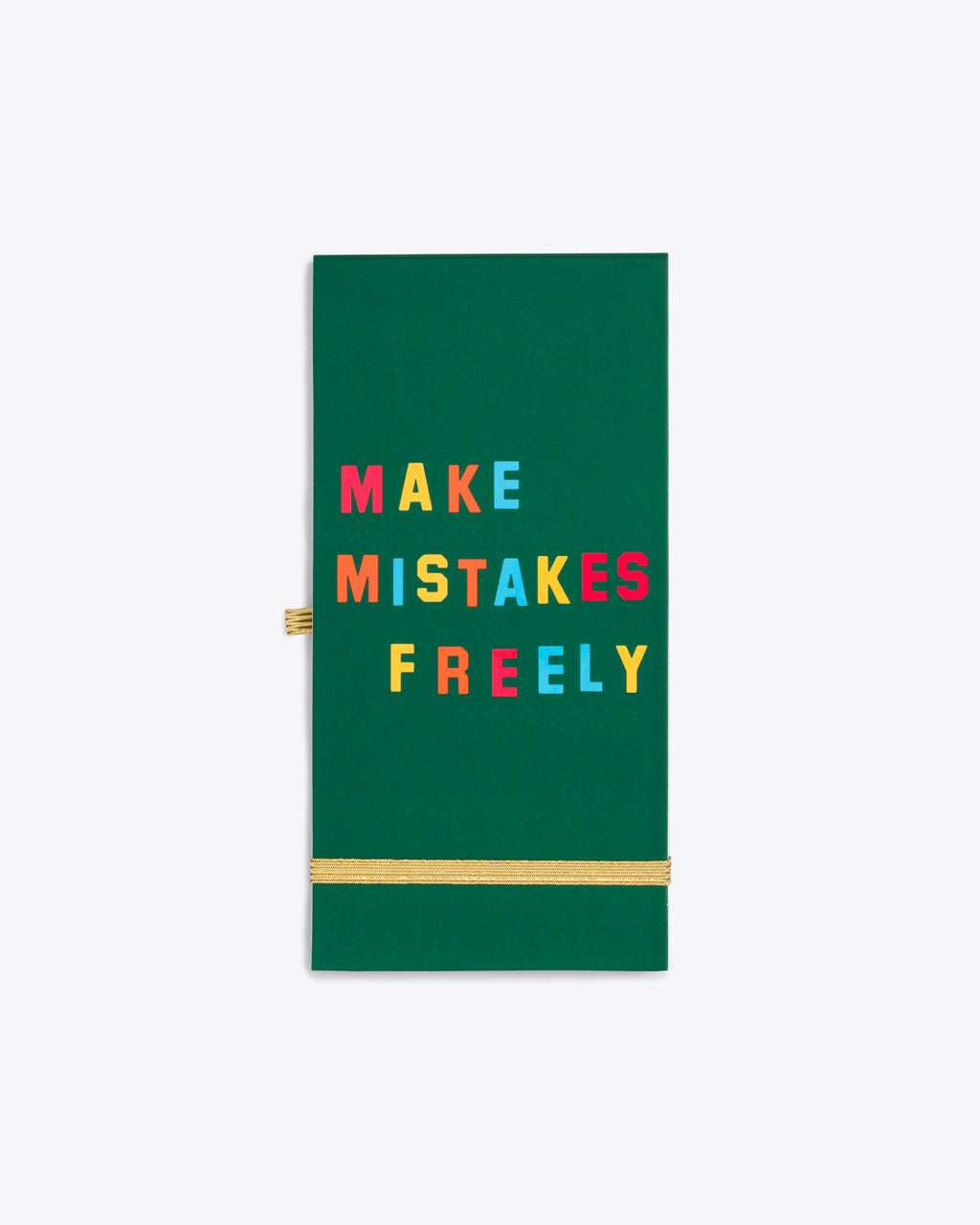 green reporter pad with the words make mistakes freely on the cover