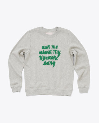 grey balloon sleeve sweatshirt with the words ask me about my karaoke song in green letters
