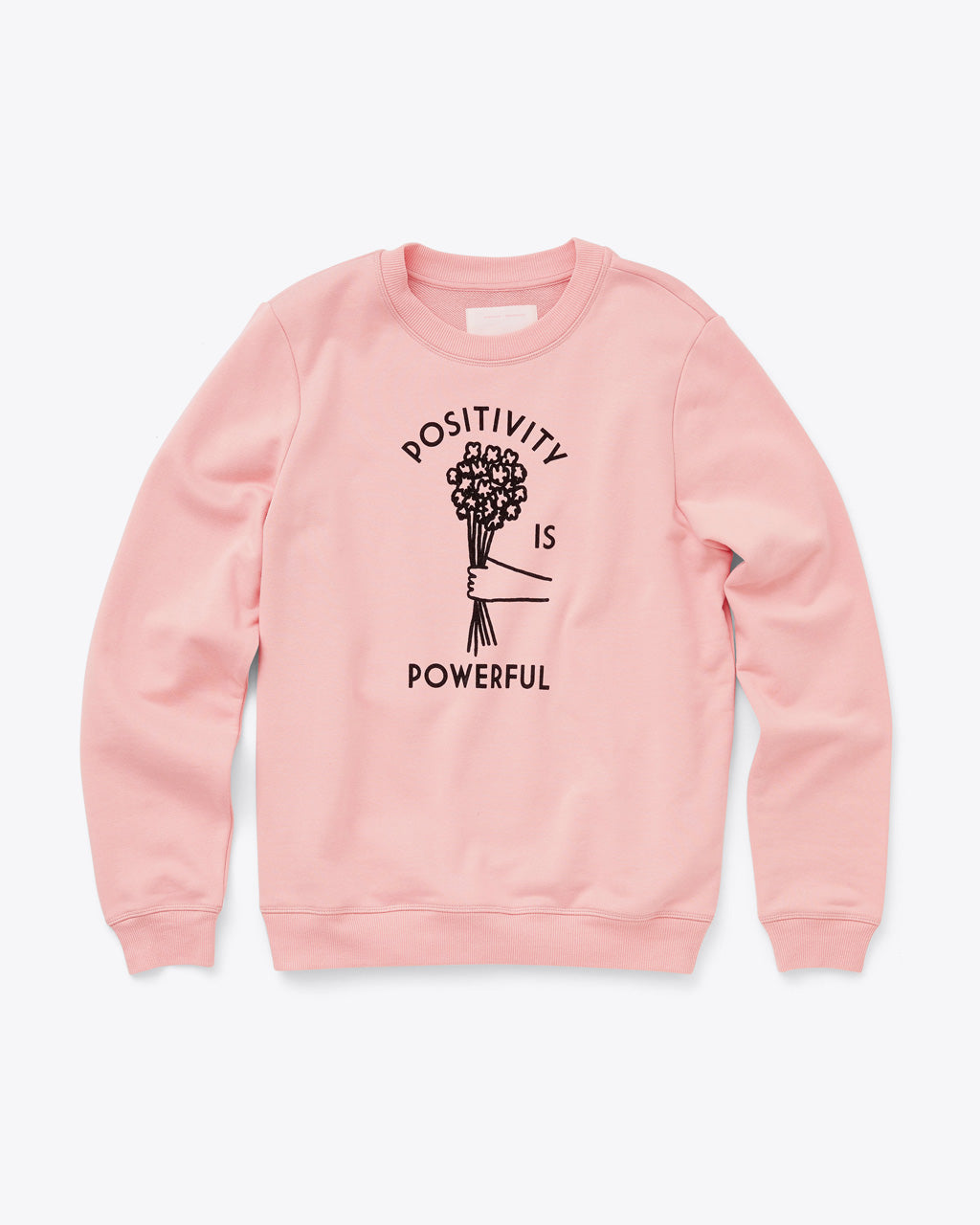 light pink sweatshirt with the words positivity is powerful and a daisy bouquet in the middle