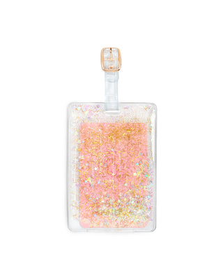 clear luggage tag filled with gold and iridescent glitter of various shapes and sizes