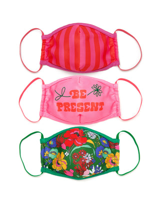 3 pack of face mask one pink and red stripe, one pink with the words be present, and one green with a floral pattern