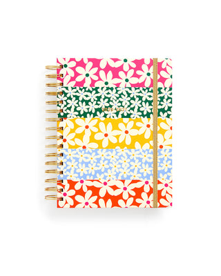 medium 17 month planner with a multi colored daisy pattern