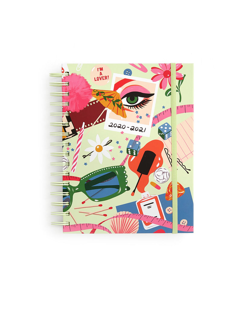 medium 17 month planner shown with a pastel green cover and an abstract design