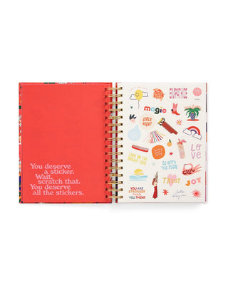 medium 17 month planner with a bright pink cover featuring a floral pattern