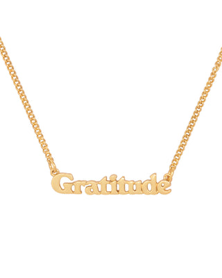 gold chain necklace with the word gratitude in 3d letters