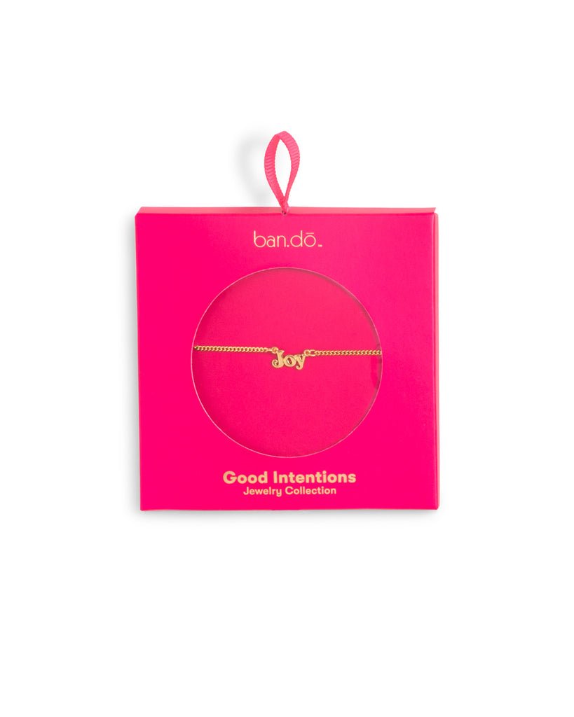 gold chain necklace with the word joy shown in hot pink packaging