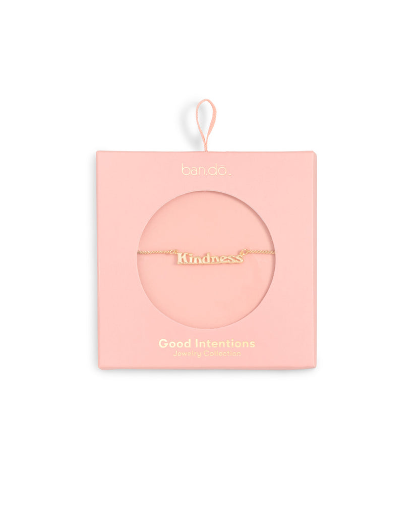 gold chain necklace with the word kindness shown in light pink box