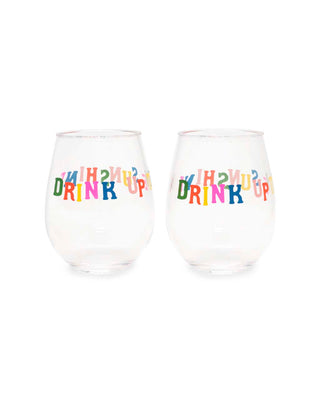 "Two stemless wineglasses with ""drink up"" printed on the front and back in rainbow text."