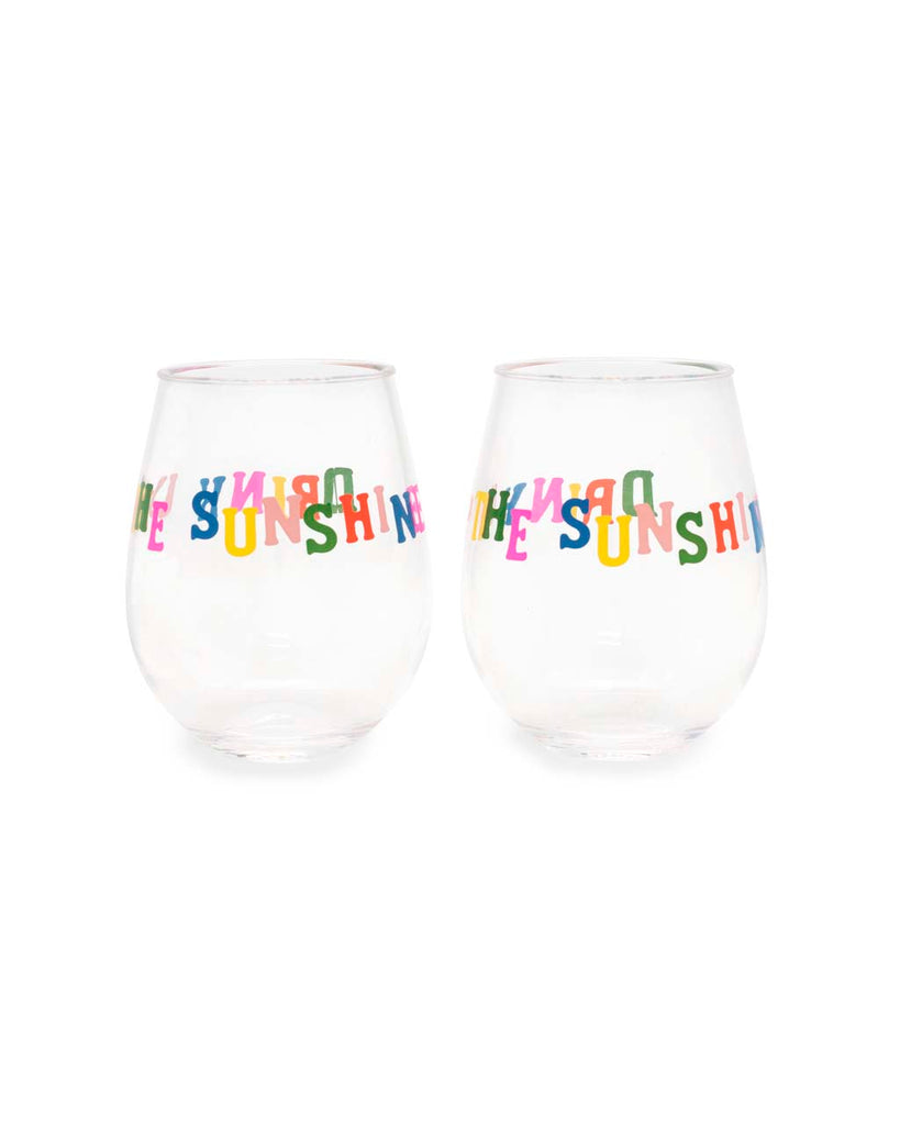 "Side view of two stemless wineglasses with ""drink up"" printed on the front and back in rainbow text."