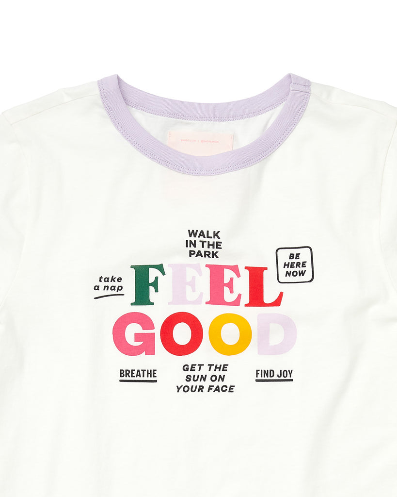 close up of white tee with a purple collar and the word art surrounding the words feel good