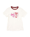 White short sleeve ringer tee with a red collar and a pink graphic of a martini glass with the phrase Glass Half Full.