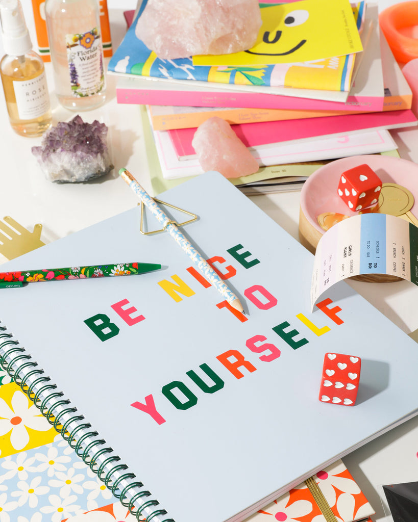 lifestyle image of notebook shown with other bando products