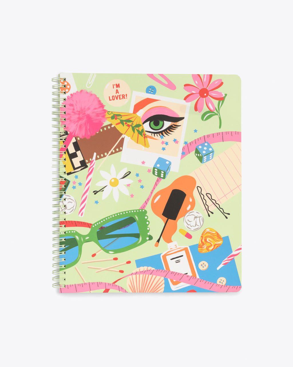 large notebook with a green cover with an abstract design