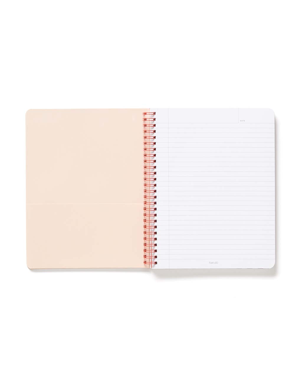 Interior view of notebook containing a blush pink pocket