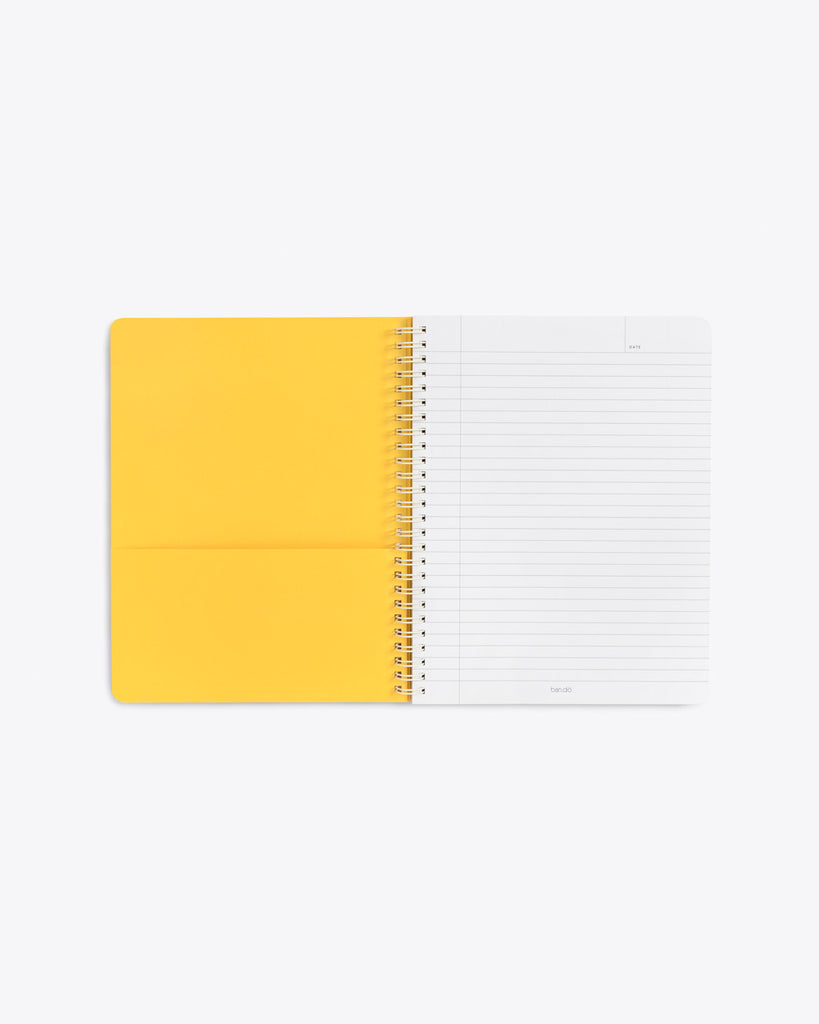 interior image of notebook showing lined pages and yellow end sheet with a pocket