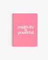 bright pink notebook with the words positivity is powerful on the cover