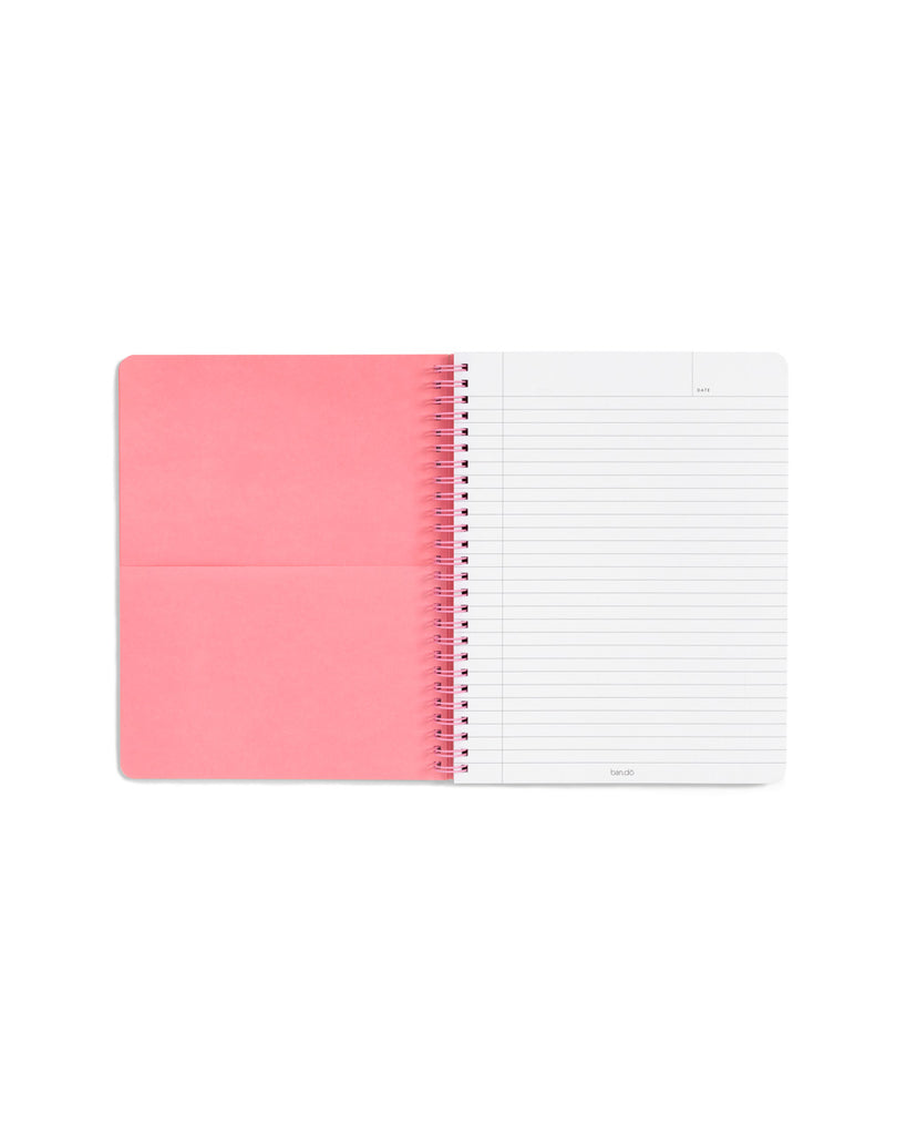 open view of spiral notebook with pink interior pocket and lined white pages
