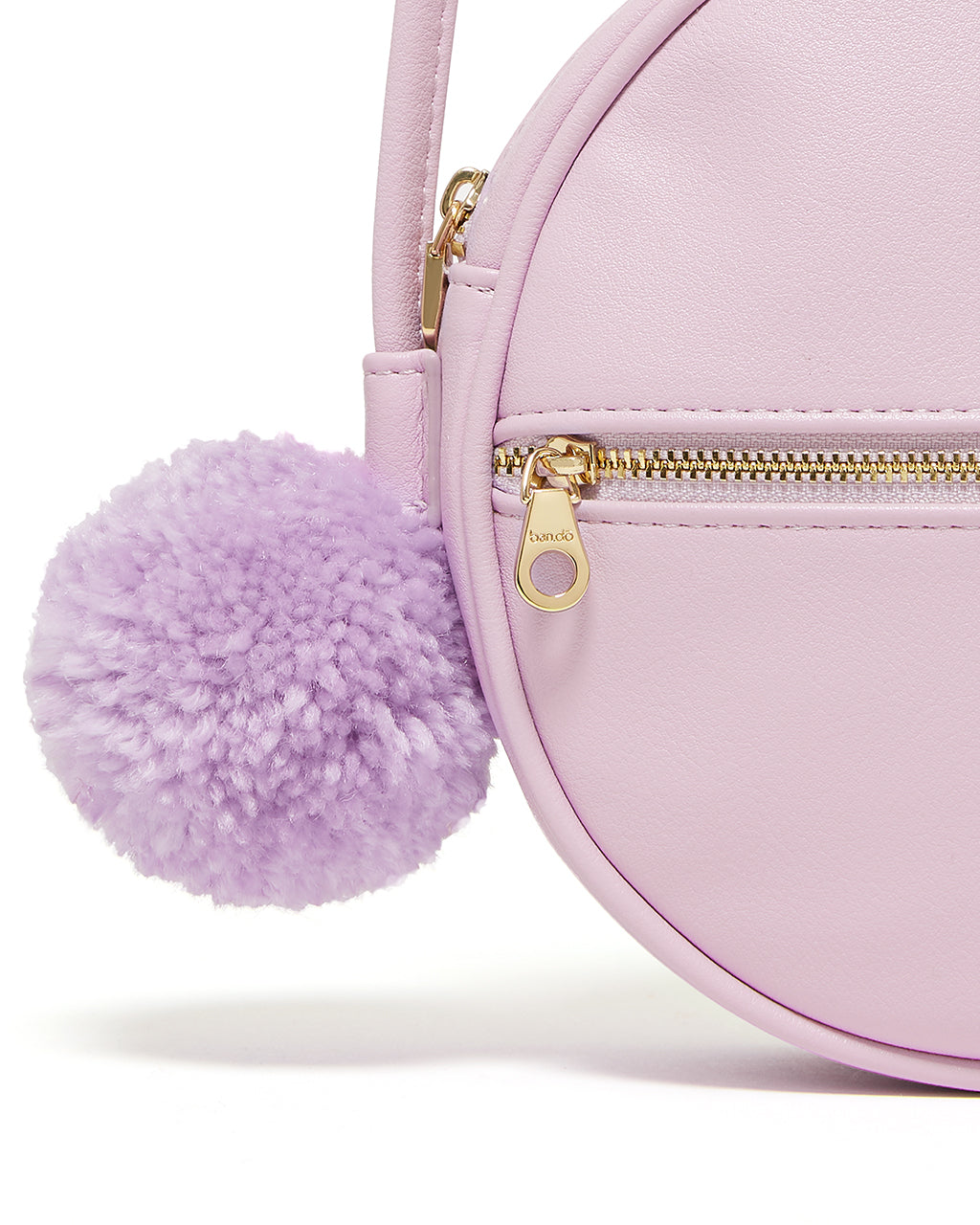 Features a detachable handmade synthetic wool pom pom.