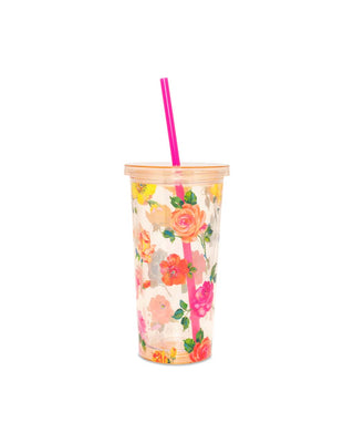 This Sip Sip Tumbler is clear with a colorful floral pattern by Helen Dealtry printed on the outside.