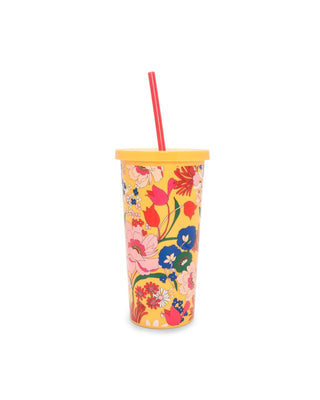 This tumbler is opaque yellow with a bright floral pattern on the side.