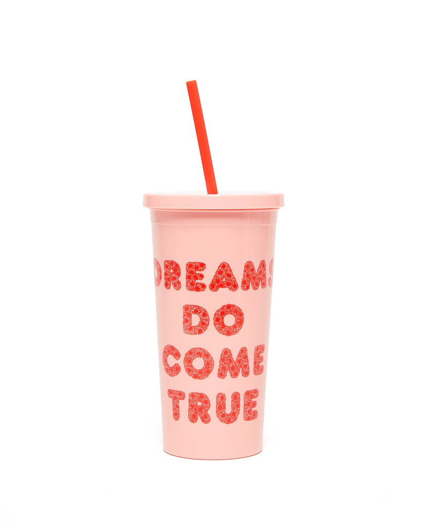 This Sip Sip Tumbler comes in pink, with 'Dreams Do Come True' printed in red on the outside.