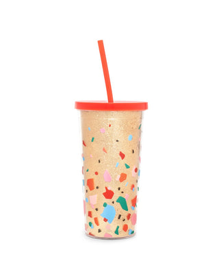 This tumbler comes in shiny gold with a bright red lid and colorful abstract shapes printed on the side.