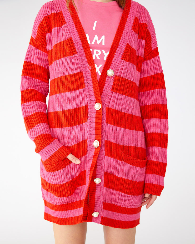 pink and red striped knit cardigan with large white buttons down the center