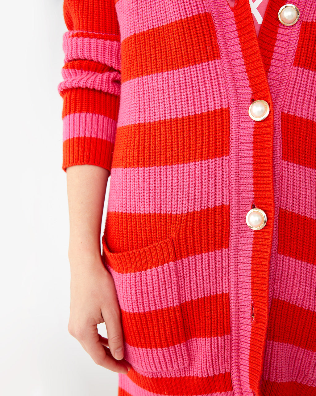 pink and red striped cardigan with large button feature down the front and pockets