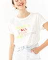 model wearing white tee with the words consider all your  menu options, paired with light wash jeans