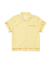 front view of yellow short sleeve leisure shirt with a daisy applique on the trim of sleeves, patch pocket, and bottom