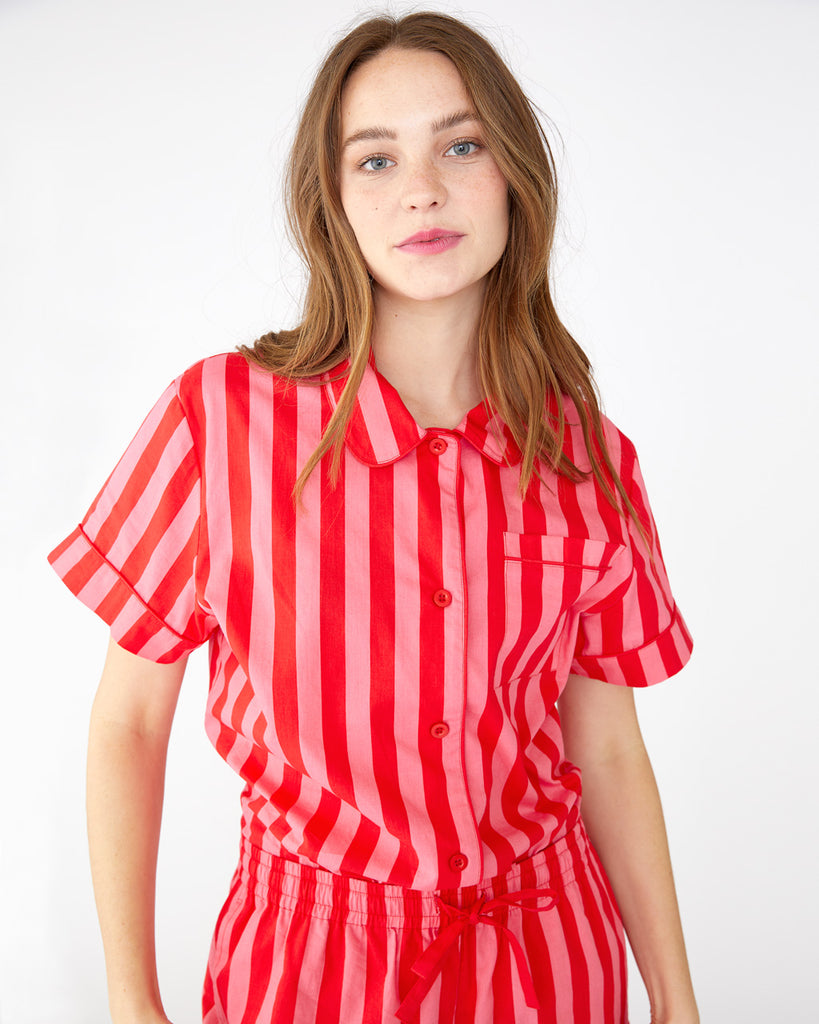 Red and pink vertical stripes featured on our short sleeve leisure shirt
