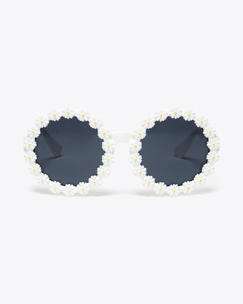 front view of white round sunglasses with a 3D daisy pattern on rim of lenses