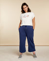 model wearing a graphic tee and navy blue wide leg sweatpants