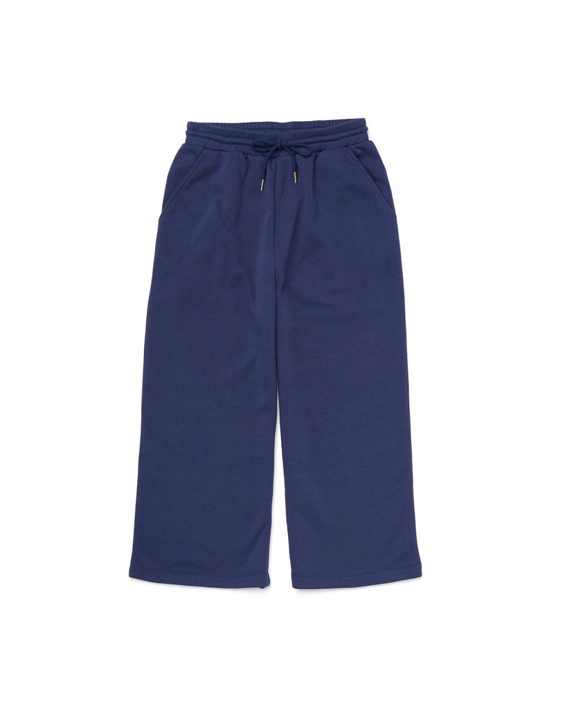 a pair of wideleg navy sweatpants with an elastic drawstring waist on a white background