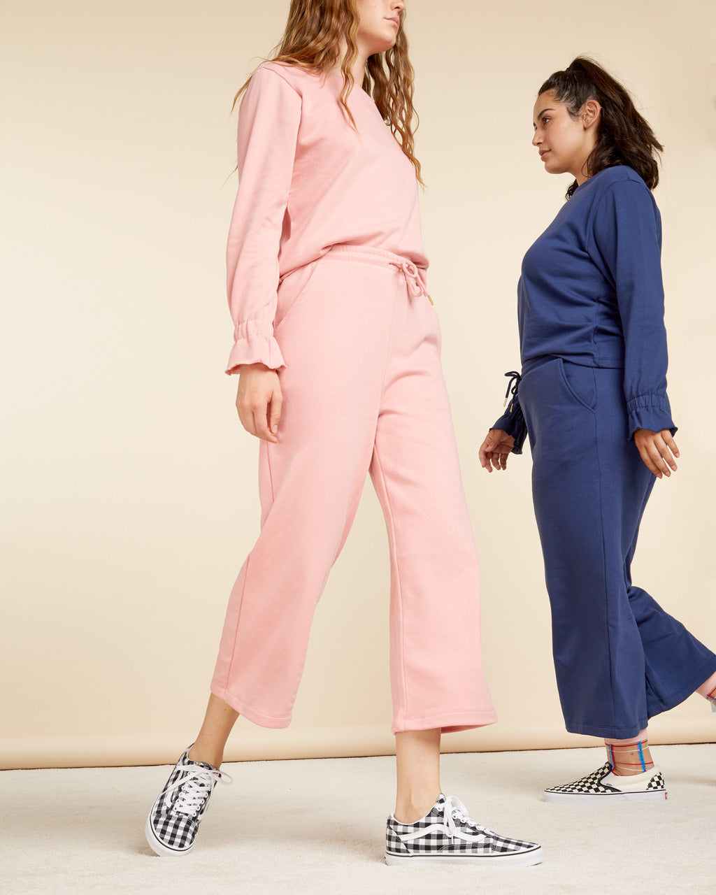 two women wearing sweatsuits