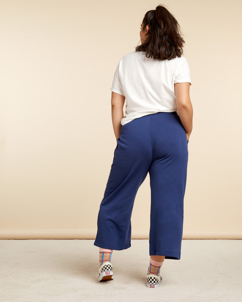 back view of model wearing navy blue wide leg sweatpants