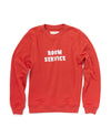 "Red long sleeve sweatshirt with a white ""Room Service"" graphic in the center."